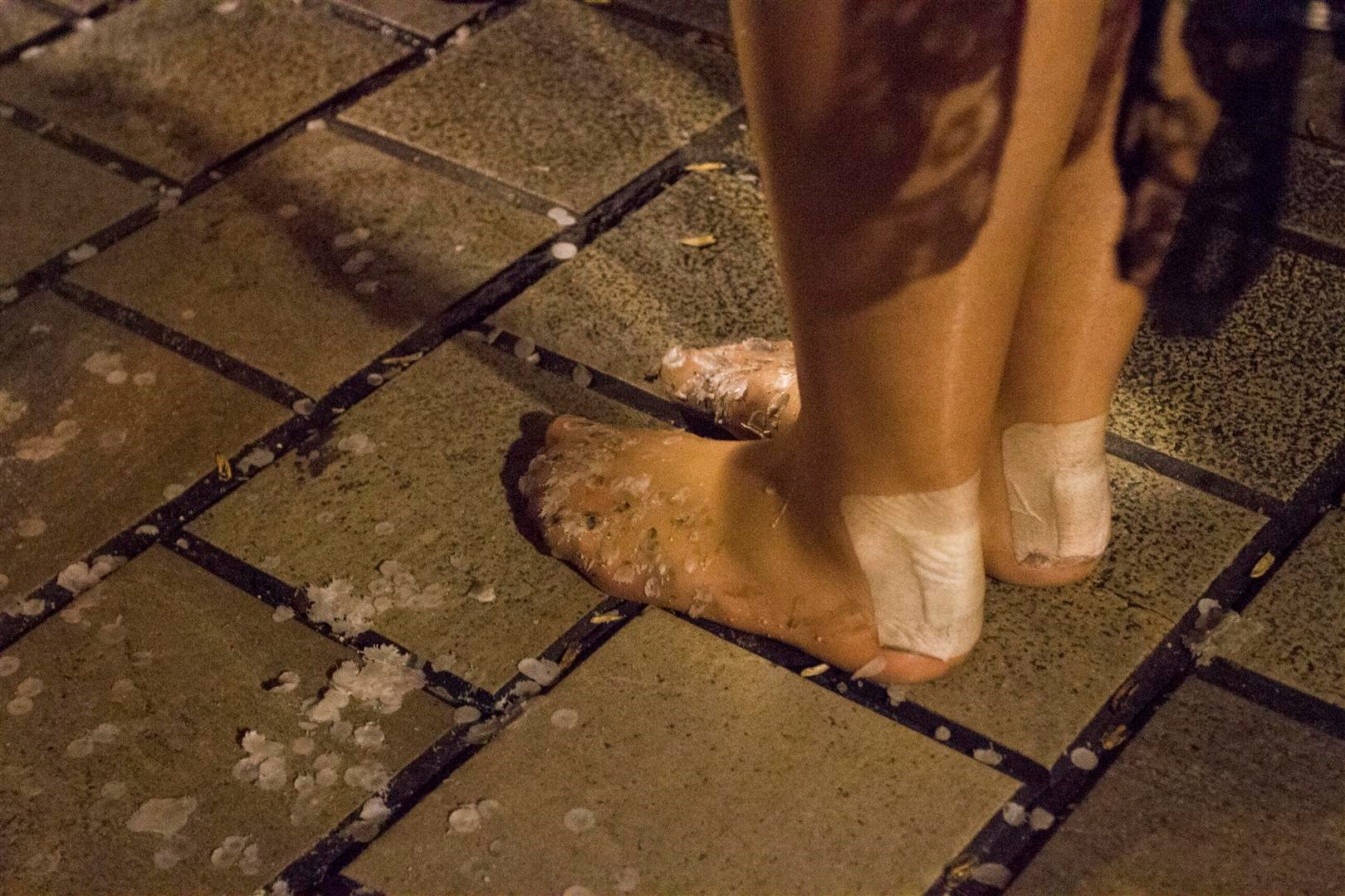 A Mantilla is walking barefoot on the streets of Granada,