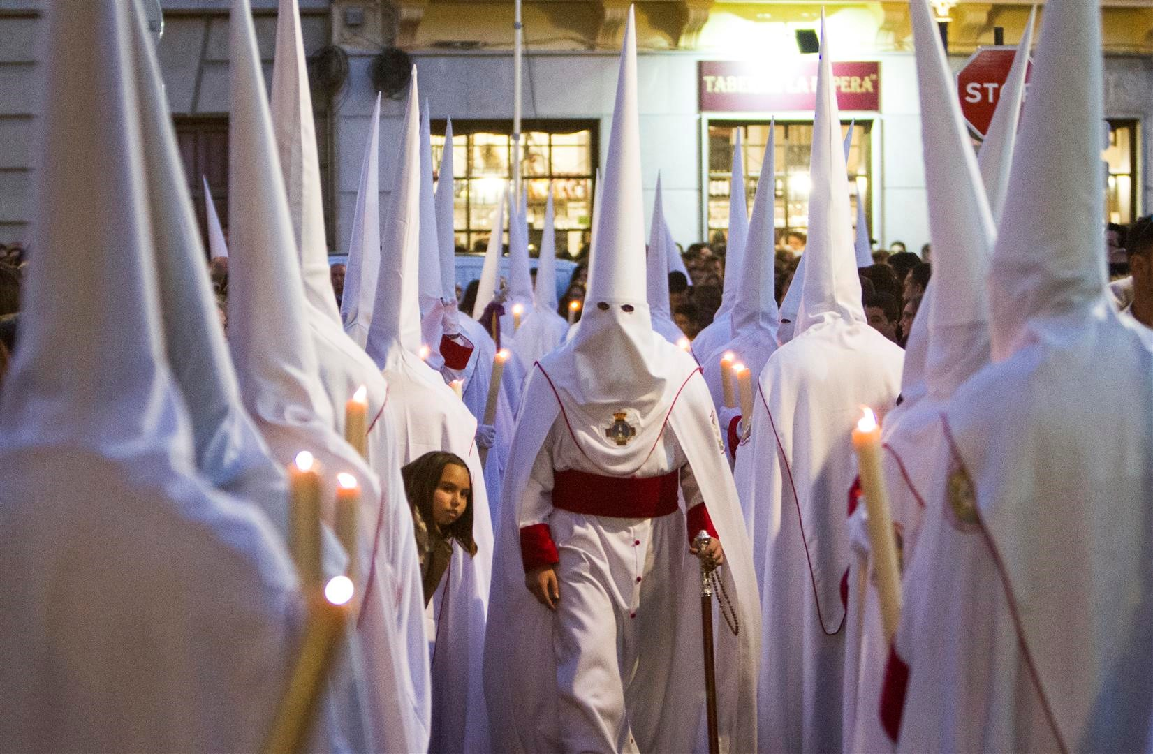 line of Penitentes to see the Christ, at a procession in Granada.